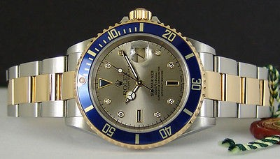 ROLEX - 40mm 18kt Gold & Stainless SUBMARINER Silver Serti Dial - 16613