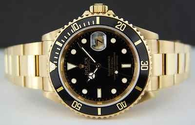 ROLEX - 40mm Submariner 18kt GOLD - Black Index Dial - 16618