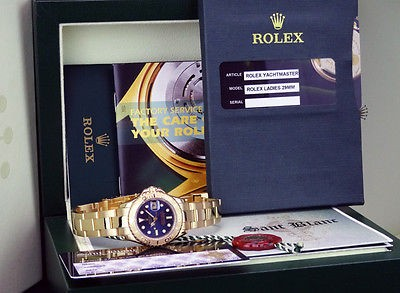 ROLEX Ladies 18kt Gold YachtMaster Blue Dial - 69628 SANT BLANC