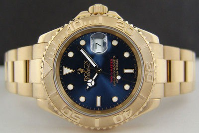 ROLEX - Mens 18kt Gold YachtMaster Blue Dial - 16628 SANT BLANC