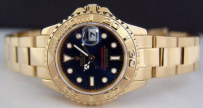 ROLEX - Ladies 18kt Gold YachtMaster - Brilliant Blue Dial - SANT BLANC