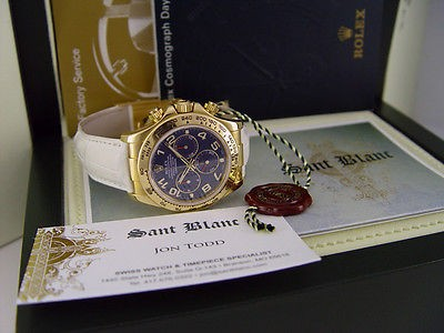 ROLEX - 40mm 18kt Yellow Gold Daytona Blue Arabic White Strap 116518- SANT BLANC